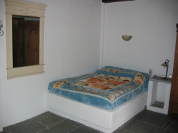 This spacious apartment has a comfortable double bed,
